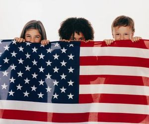 kids behind flag